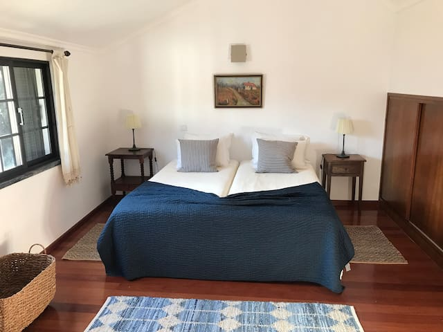 The is one of two large bedrooms on the second floor of the apartment, with a view to Monte Brasil.