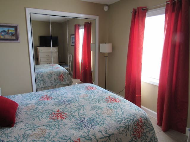 2nd bedroom; queen size bed; adjoining full bath; armoire with tv
