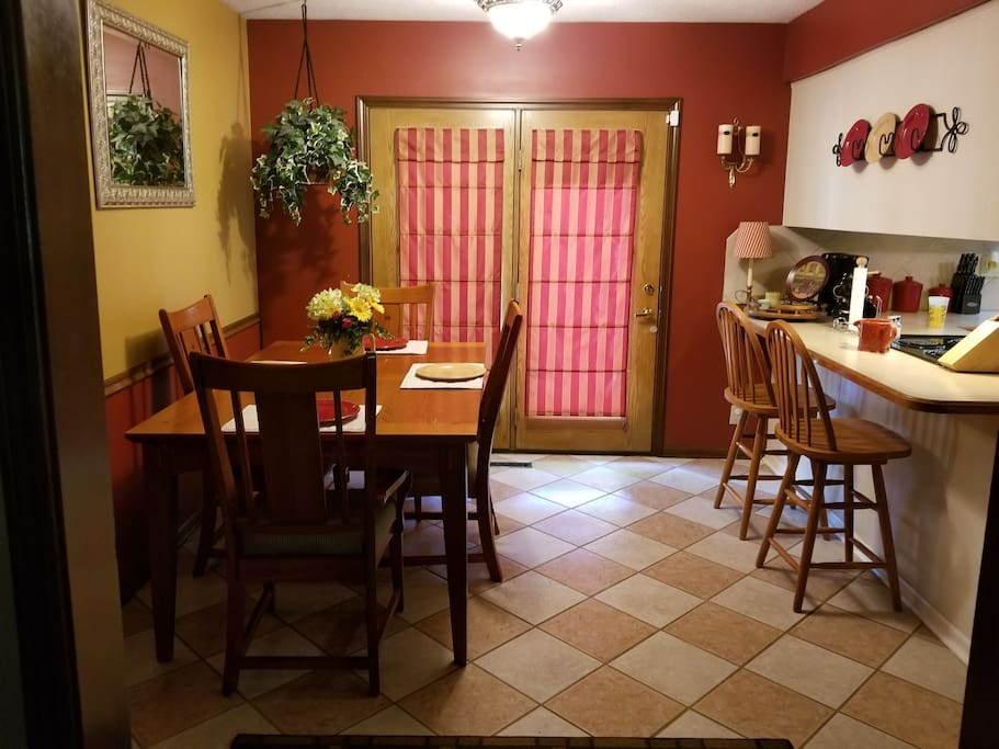 Dining room with eat-in kitchen has ceramic tile & French doors out to large deck