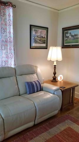 Living Room - This room, at the entry of the home, features a new (February 2019) leather sofa with double recliners.  The room also includes a new small side chair recliner (March 2019). TV is Direct TV channels to keep up with your favorite shows.