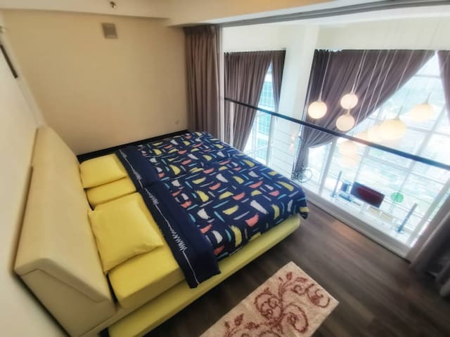 Bedroom at mezzanine, sleeps 4 pax (2 pull-out bottom bed)