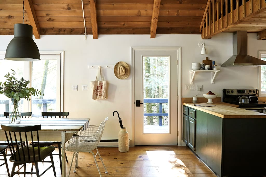The front entry and dining area. A set of sliding glass doors (at left) is one of two in the double-height living space.