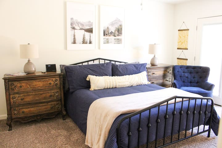Our Master bedroom holds a queen bed, lots of room, two nightstand lamps, and has two french doors with access to the backyard area.
