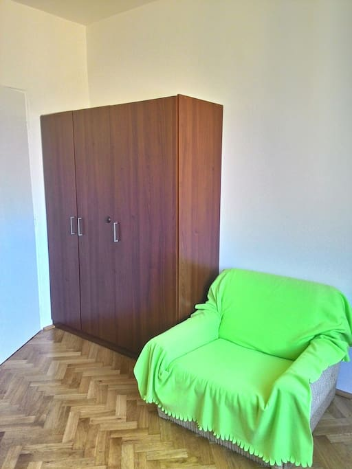 Wardrobe and armchair in the room