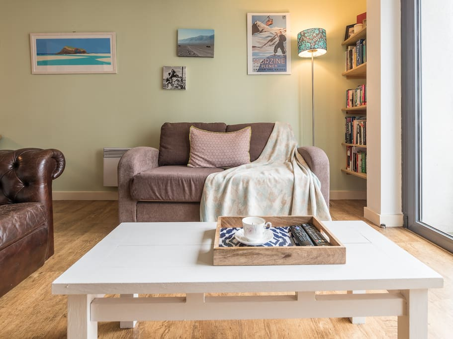 The living area is a bright and comfy space in which to relax