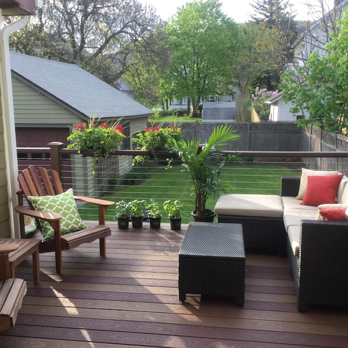 Relax with friends or family on our new back deck overlooking our private yard. New gas grill available for great bbq time (please note grill cleaning fee in description).