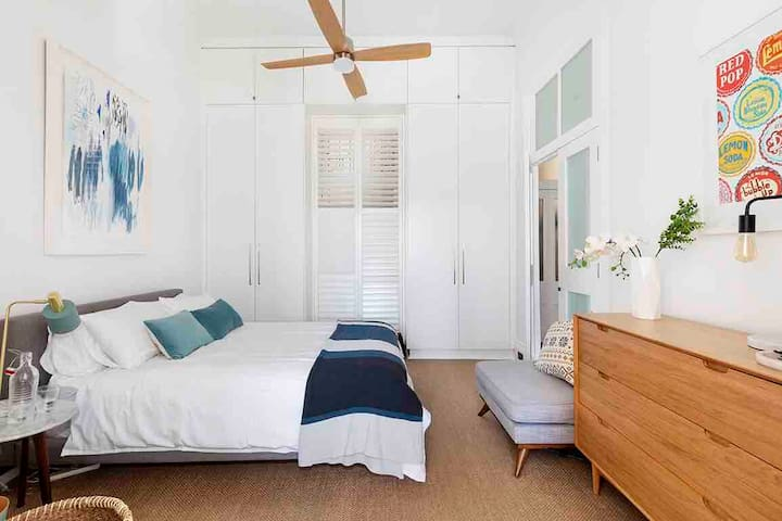 Separate Bedroom with Queen bed, full hanging cupboards and overhead remote control fan for the warmer nights.