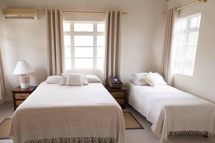 Second upstairs bedroom with en-suite bathroom and walk-in wardrobe,
