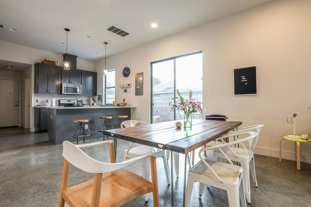 Open floor plan dining room with a handmade table that seats 6 or more