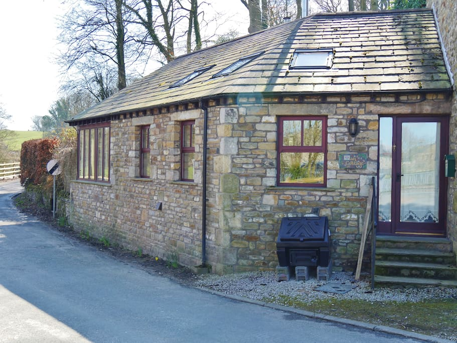 Stone built cottage overlooking the river Wenning.