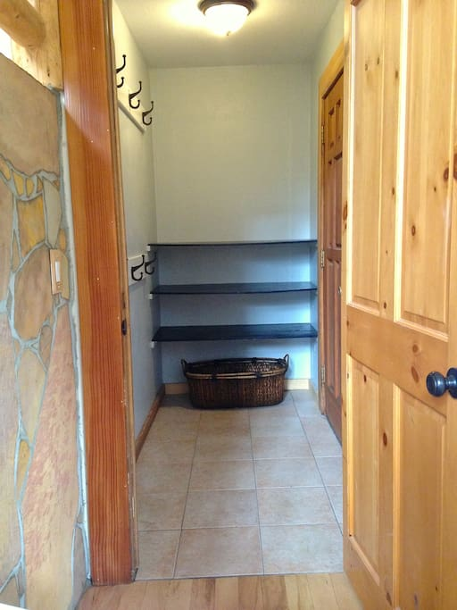 Entry way with plenty of room for coats, shoes and gear.