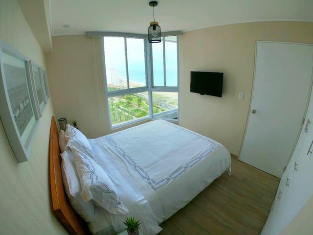 Oceanview Master bedroom with queen size bed and premium mattress