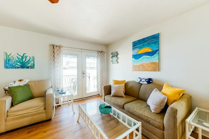 Relax by the beach at this charming condo w/ a shared, outdoor pool & free WiFi