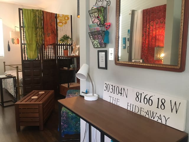 Clearly, we Love bright fabrics, original art and gardening.  This makes us partial to family heirlooms, garage sales, roadside and flea market finds.  Speaking of, check out that Shoji screen!  The sign is one of a kind though, Thanks Auntie B