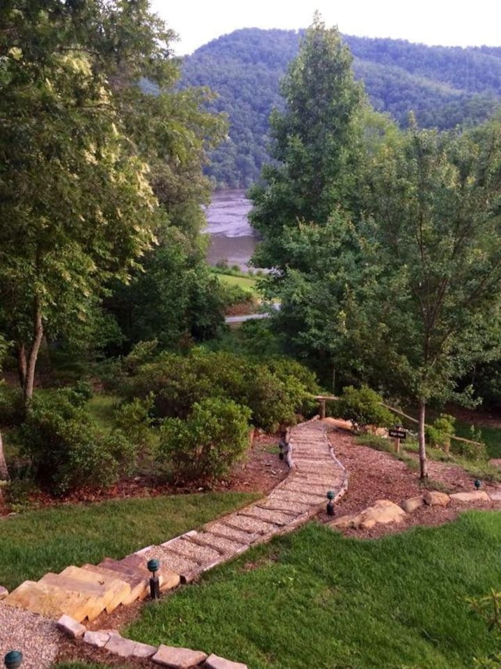Spring view of the Little Tennessee River and steps down to the Fire Pit Plateau and putting green.