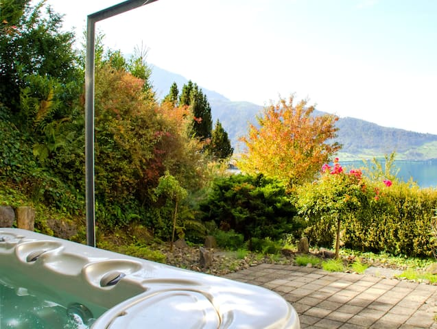 Private whirlpool with amazing view of lake and mountains