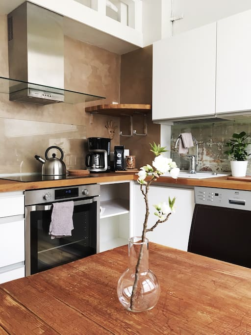 Fully equipped & cozy kitchen has everything you need for snacking and cooking.
