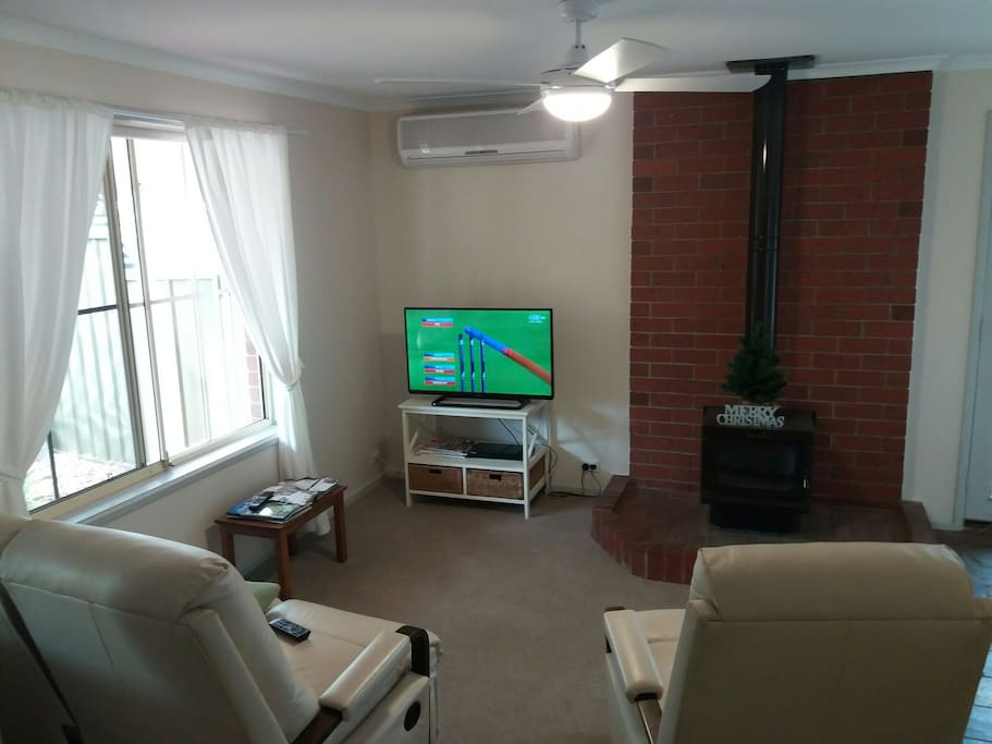 "TV corner - 40"" TV, Blu-ray player with access to Netflix and Stan included, air-conditioner and cosy wood heater."