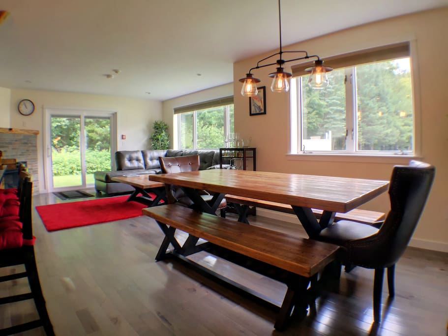 Dining table with seating for six, plus four stools at the island.