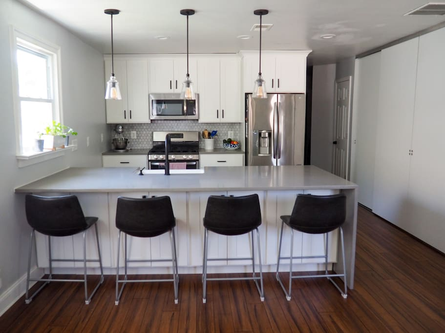 Open kitchen space with large peninsula.