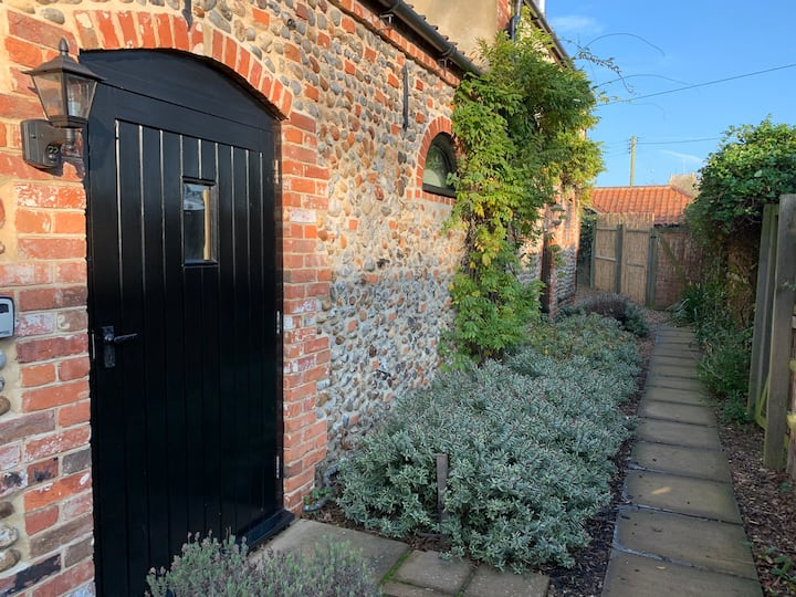 The Coach House, a stylish converted flint barn