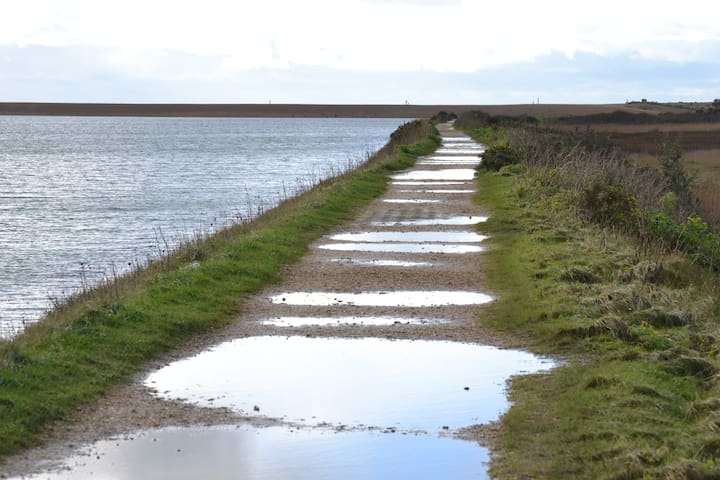 Walk along sea wall at Keyhaven with wellies on!