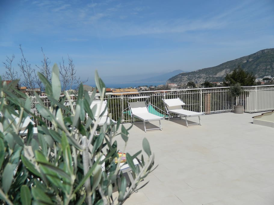 Exclusive Terrace Solarium equipped with sun beds, sun chairs, shower, tables, chairs, barbecue and gazebo