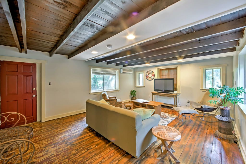 Hardwood floors and beautiful wood ceilings fill the interior of the main living space.