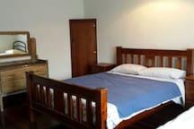 Room 1 Queen bed + Single sofa bed