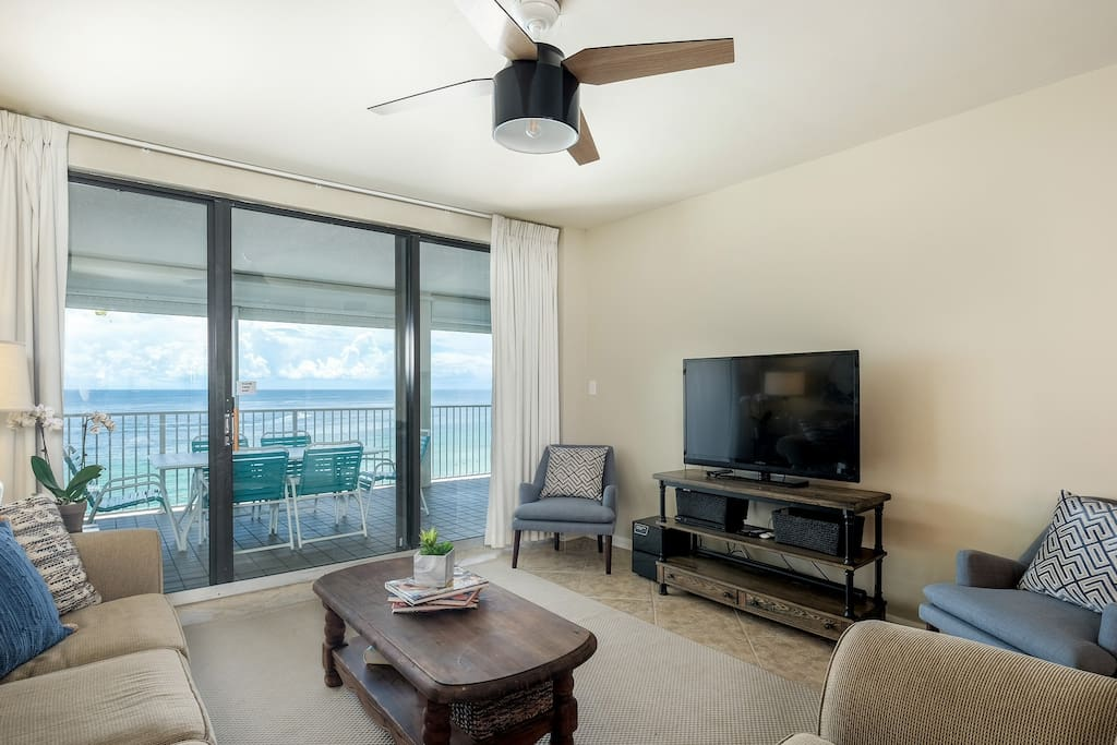 Updated living room with Flat screen TV/ DVD player and view of the beach