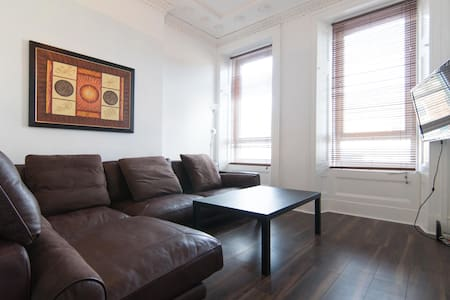 Large modern comfy apartment, free onsite parking.