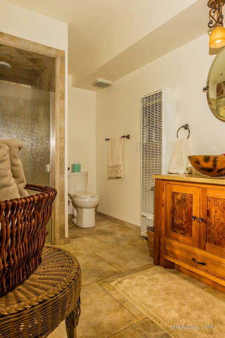 Modern bathroom is spacious, featuring a nice, clean tiled shower.