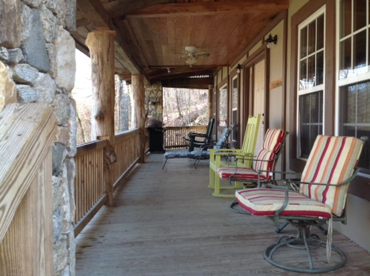 Front porch with rock columns and large poplar logs