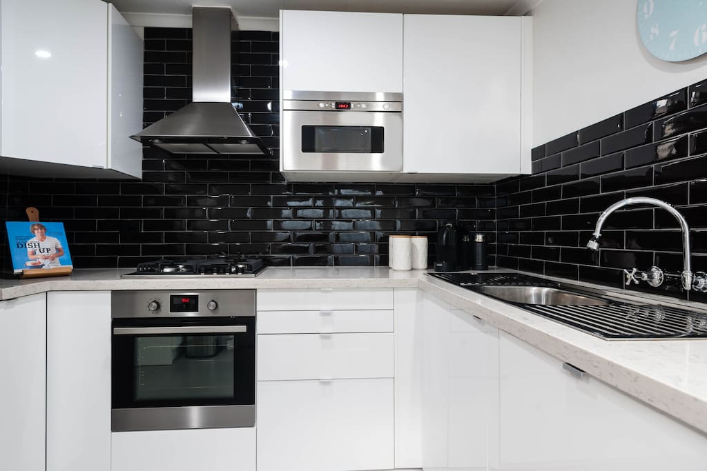 Our fully renovated kitchen, we include basic cooking supplies and have a coffee machine for your use.