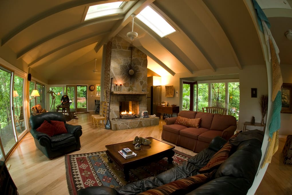 Lovely open floor plan with expansive views, all glass & double sided fireplace