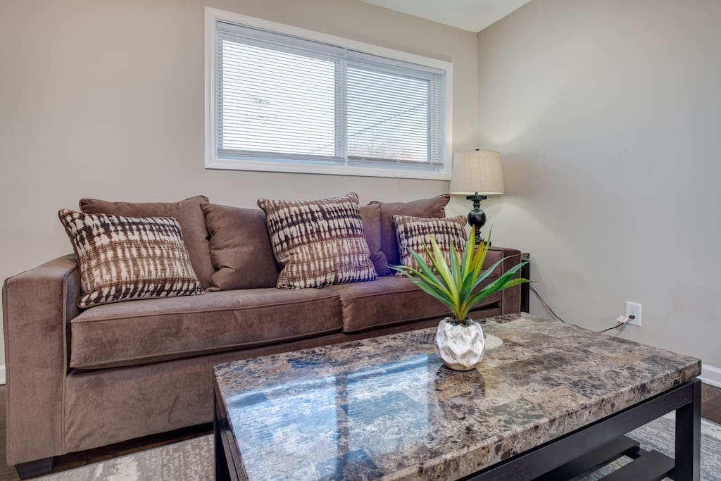 "Relax in Unit 1's cozy living space featuring a queen-size sleeper sofa and a 42"" flat screen TV."