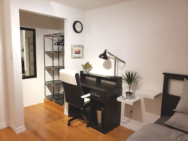 This comfy office chair & desk makes the perfect work station. Behind it is the walk in closet equipped with shelving, hooks & hangers for all your clothes.