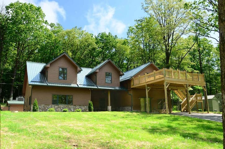 Split lakefront home with private dock, gazebo, hot tub and fire pit!