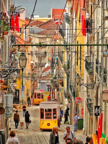 Trendy Bairro Alto full of authentic trams and colourful streets.