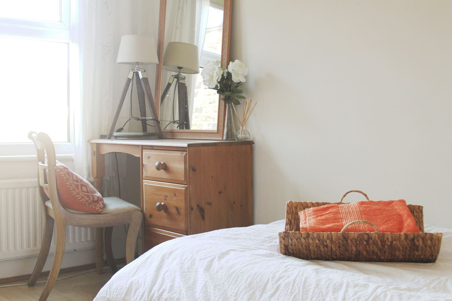This it the White Room, it's a welcoming room with a desk area with a view out to the back garden, an easy going atmosphere, with wifi, a towel, hairdryer, bedside water, all provided so you can relax in your own space.