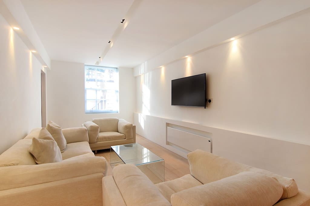 The bright, luxurious lounge area with large flat screen TV and Free WiFi