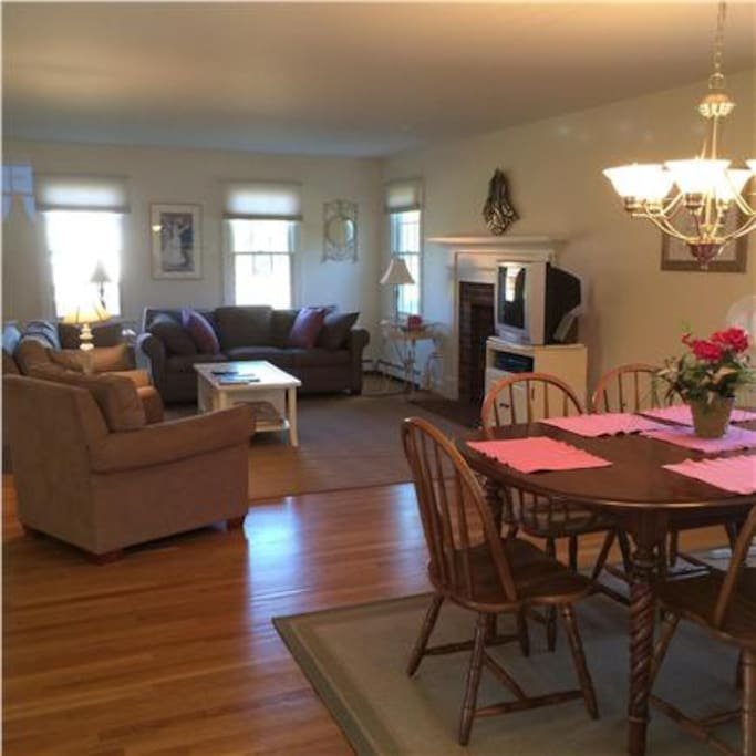 The living room/dining room is a spacious open plan with a slider to a large screened porch.