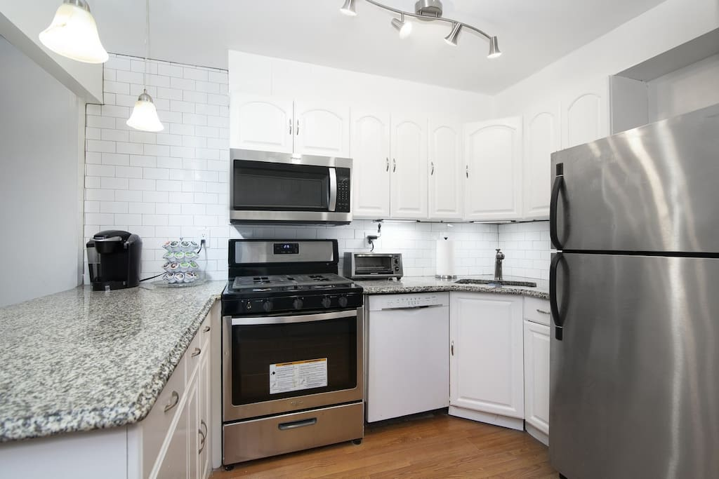 Modern, stainless steel Kitchen with complimentary coffee!