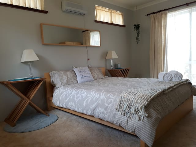 Queen master bedroom. Wardrobe, robes and storage avail. Private entry or exist to rear yard for parents.