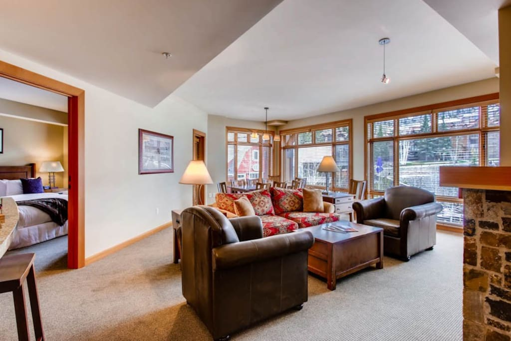 Open living area with views of Snowmass Mountain, ample sitting room, flat screen TV, and gas fireplace