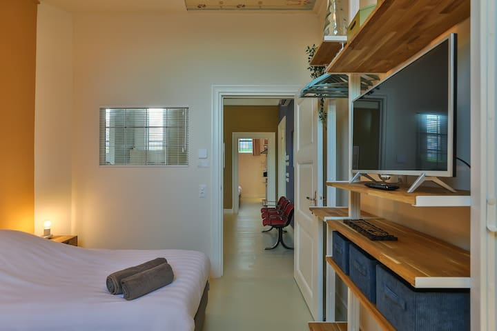 Bedroom 4 with 2 single beds and ensuite bathroom (TV only streaming content)