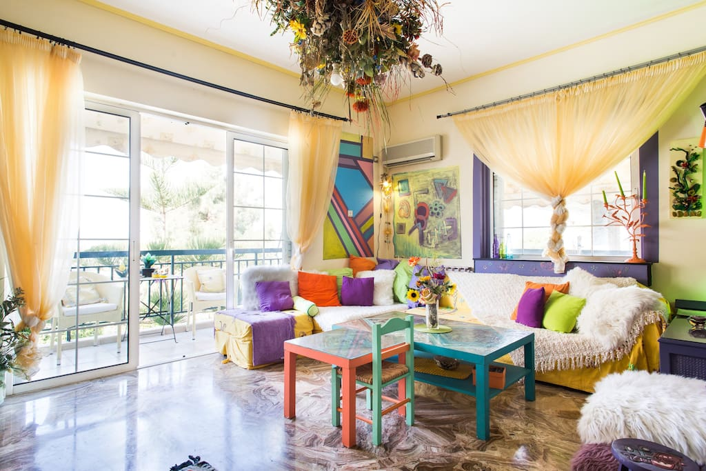 Living room with large window door leading to balcony