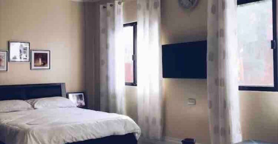 1 bedroom with comfy queen size bed, sofa, cable TV and closet.