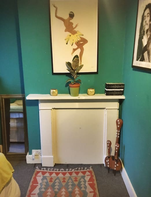 Bright, Double bedroom with large window, wardrobe and chest of drawers.