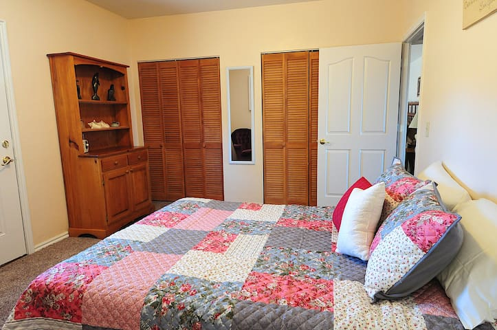 Cute country style bedroom #2. With queen bed. Door opens onto patio.